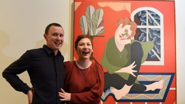 Mitch Cairns, the winner of the Archibald Prize, with his winning painting and its subject, his artist partner Agatha Gothe-Snape.
