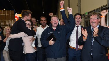 Former Northern Ireland finance minister Sammy Wilson (far right) leads celebrations for the Leave campaign at the count in Belfast.