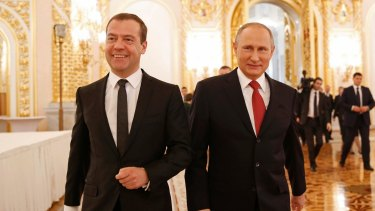 Russian President Vladimir Putin, right, and PM Dmitry Medvedev after Putin's state-of-the-nation address when Putin hoped for mending a rift with the US and pooling efforts in fighting terrorism.