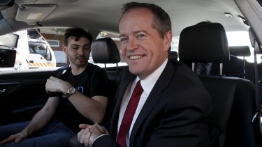 Bill Shorten visits Google's Pyrmont offices to talk with young software engineer Fabian Tamp, in the Google Car of the future.
