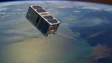 An artist's impression of an Australian mini-satellite orbiting Earth.