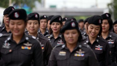 Police officers deployed outside the Thai Supreme Court ahead of the scheduled  verdict on charges accusing former Prime Minister Yingluck Shinawatra of negligence in implementing a rice subsidy.