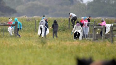 Potential illegal workers try to flee during a Border Force raid on Vizzarri Farms in Koo Wee Rup, Victoria.