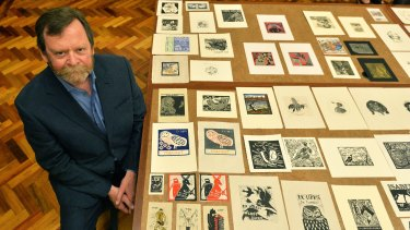 Robert Littlewood with some of the bookplates included in the exhibition.