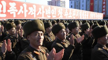 North Korean military personnel clap hands in a rally, after North Korea said it had conducted a hydrogen bomb test in January.