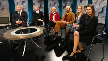 Politicians of the leading parties sit in a TV studio in Reykjavik, Iceland.