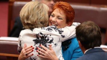 Senator Michaelia Cash hugs Senator Pauline Hanson after her first speech to the Senate in September.