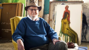 """Lawrence Ferlinghetti sits next to his painting, """"Monkey on Back"""", at his studio in San Francisco, aged 97."""