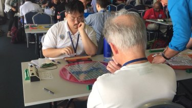Competitors consider their next move in the 2015 World Scrabble Championships in Perth.