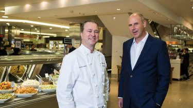 Celebrity chef Neil Perry (left) with David Jones CEO John Dixon: The department store's appetite for Australia's upmarket foodies could hurt Coles and Woolworths, credit agency Moody's warns.