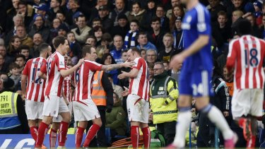 Charlie Adam celebrates with team mates after scoring from his team's side of halfway.