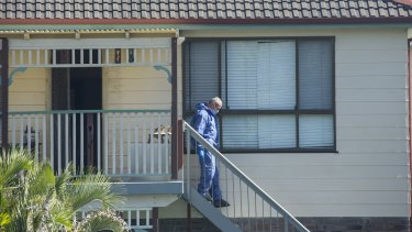 Forensic officers search the Bundeena home where Ms Kontozis died.