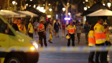 Emergency workers stand on a blocked street in Barcelona, Spain after an IS-linked terror attack.