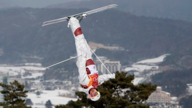 Defying gravity: Mikael Kingsbury jumps during the men's moguls qualifier.