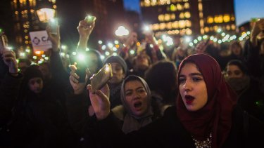 At Washington Square Park in New York, Muslim women shout slogans during a rally against President Donald Trump's order which aims to crack down on immigrants living in the US.