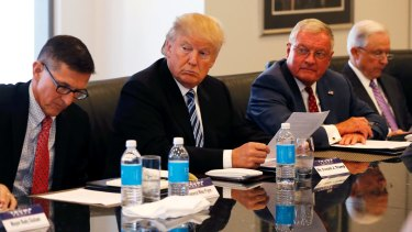 Donald Trump participates in a roundtable discussion on national security last year with retired army general Michael Flynn, left, and senator Jeff Sessions, far right.