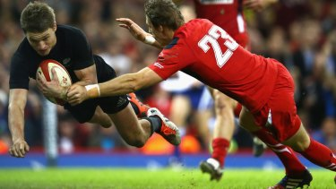 Beauden Barrett dives over to score the All Blacks' third try.