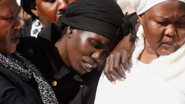 Akon Guode at the funeral of her three children last year.