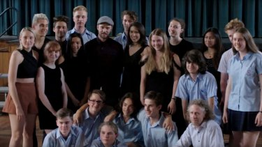 Justin Timberlake with students from Newtown's High School Of The Performing Arts.
