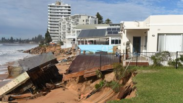 Damaged beachfront homes along Pittwater Road at Collaroy.