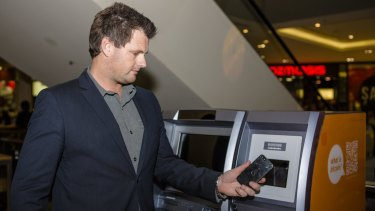 Australian Bitcoin ATMs director Robert Masters uses Canberra's first Two-Way Bitcoin ATM at Canberra Centre. Photo by: Jamila Toderas