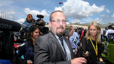 Media attempt to question Senator Ricky Muir outside Parliament House on Tuesday.