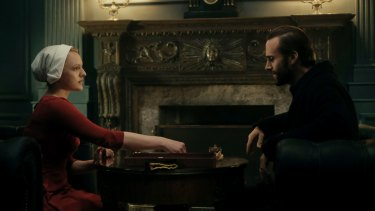Offred (Elisabeth Moss) and Commander Waterford (Joseph Fiennes) in The Handmaid's Tale.