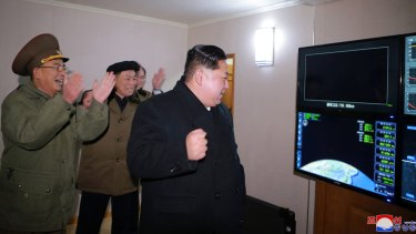 North Korean leader Kim Jong-un watches a missile launch on a screen on Wednesday.