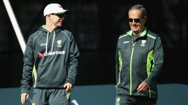 Recovery: Chris Rogers  and Australian team doctor Peter Brukner during  the tour match in Derbyshire.