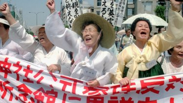 South Korean women protest the cover-up of the use of 'comfort women' in WWII, during a protest in Tokyo in 1995.