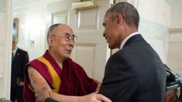 US President Barack Obama greets His Holiness the Dalai Lama at the White House.