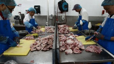 About 14,000 chickens are processed in this Marrickville factory every day.