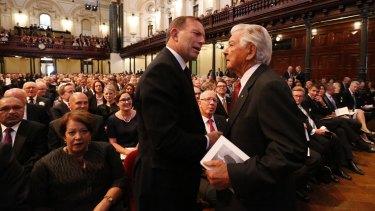 Tony Abbott and Bob Hawke at the memorial inside Sydney Town Hall.