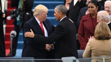 Barack Obama greets Donald Trump at the new President's inauguration.
