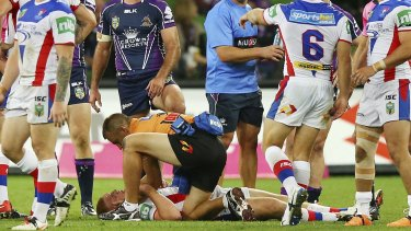 Tragic incident: The fateful tackle that left Alex McKinnon in a wheelchair.