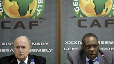 Cameroon's Issa Hayatou (right) will take over FIFA in Sepp Blatter's absence.