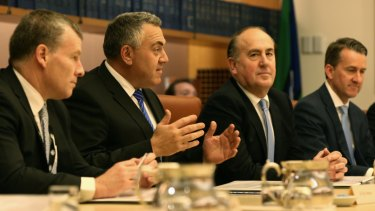 Treasurer Joe Hockey, at centre) met with state and territory Treasurers to announce the new policy.