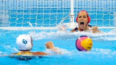 Hungarian goalkeeper Orsolya Kaso reacts after a shot by Bronwen Knox hits the post.