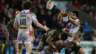 Mose Masoe of St Helens passes the ball.