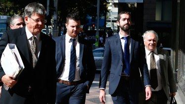 Barry Lyttle (centre) arrives at court with his lawyer Chris Watson (left) and brother Patrick (right).