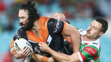 """We tried to look after him"": Aaron Woods of the Tigers is tackled."