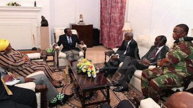 Robert Mugabe met with senior military officers and envoys from the Southern African Development Community at State House, his official residence in Harare.