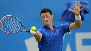 Bernard Tomic in action during his Queen's Club semi-final against Canadian Milos Raonic.