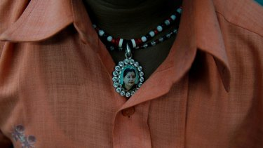 A supporter wears a locket with a picture of India's Tamil Nadu state Chief Minister Jayaram Jayalalithaa.