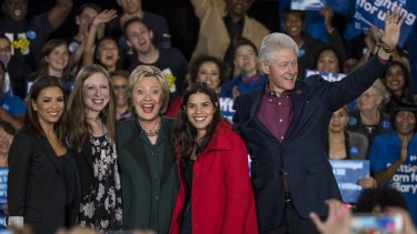 Actress Eva Longoria, from left, Chelsea Clinton, Hillary Clinton, actress America Ferrera and Bill Clinton wave to attendees during a campaign rally in Las Vegas.