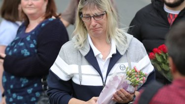 People arrive with floral tributes after the murder of Jo Cox.