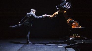 Taiwanese dancer and choreographer Huang Yi  performs a duet with KUKA the robot.