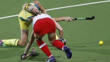 Last ditch effort: Jodie Kenny scores for the Hockeyroos with 15 seconds left in the match.