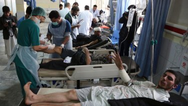Victims receive treatment in hospital after a suicide attack in Kabul on Saturday.