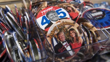 Pressing buttons: Presidential inauguration souvenirs on sale at the White House.
